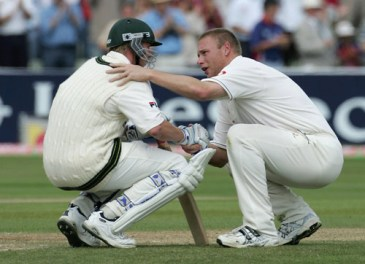 Flintoff consolidating Brett Lee after the sensational win for England