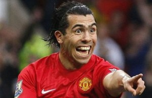 Carlos Tevez tricks in Manchester City win