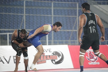 Lakha of Punjab Thunder trying to stop Lovepreet Singh of United Singhs