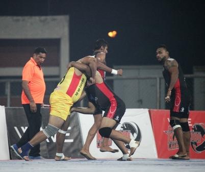 Yadwinder Singh of Punjab Thunder trying to stop Gursewak Singh Goldy of Yo Yo Tigers