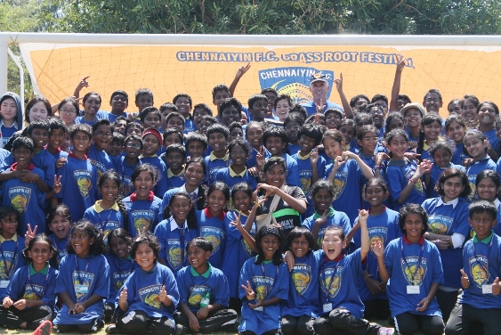 Kids pose with ISL Grassroots Technical Director Piet Hubers