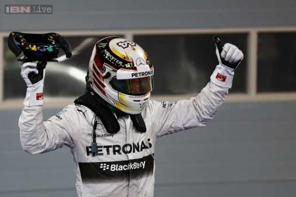 Lewis keeps Kimi's threat at bay to win Bahrain GP