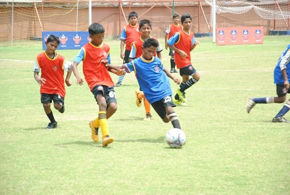 Kids playing during FC Goa's Grassroots Festival at Tilak Maidan, Vasco