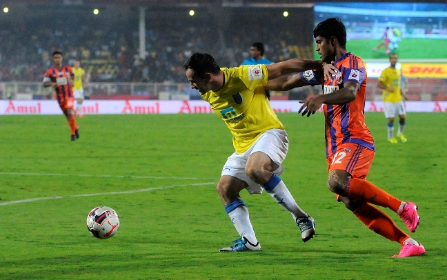 Chris Dagnall of Kerala Blasters FC and Pritam Kotal of FC Pune City in action