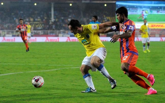 Chris Dagnall of Kerala Blasters FC and Pritam Kotal of FC Pune City in action