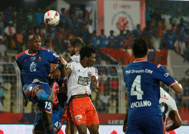 FC Goa players defends a corner along with Gregory Arnolin