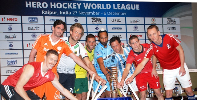 Captains from 8 qualified teams pose with the Hero Hockey World League trophy.