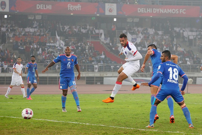 Robin Singh of Delhi Dynamos FC heads the ball to score the opening goal