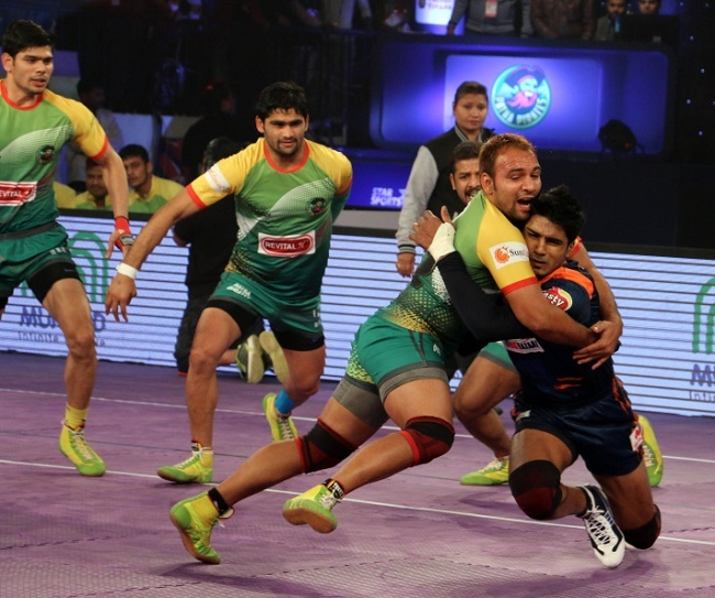 Sunil of Patna Pirates trying to stall Shrikant Jadhav's march into his own half with a front tackle in the Star Sports Pro Kabaddi season 3 in Patna