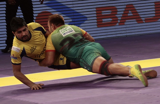 Patna Pirates defender Sunil dashes and knocks out Rohit Baliyan of the Telugu Titans in match 51 of the Star Sports Pro Kabaddi season 3 in Mumbai