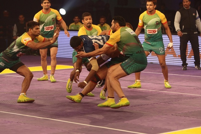 Selvamani of Dabang Delhi K.C. being tackled by the Patna Pirates captain Manpreet Singh and Sunil as Amit Hooda closes in, in match 23 of the Star Sports Pro Kabaddi season 3 in Pune