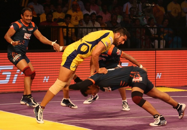Girish Ernak goes low to stop and immobilise Rahul Chaudhari with a double thigh hold in match no 7 of the Star Sports Pro Kabaddi season 3 in Vizag