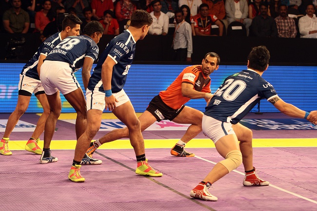 Anup Kumar gains a bonus point for U Mumba in match 56 the Star Sport Pro Kabaddi season 3 in Mumbai