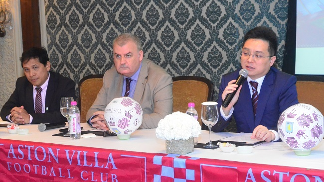 Aston Villa chairman (r) Tony Xia addresses the media in New Delhi announcing the launch of its Academy