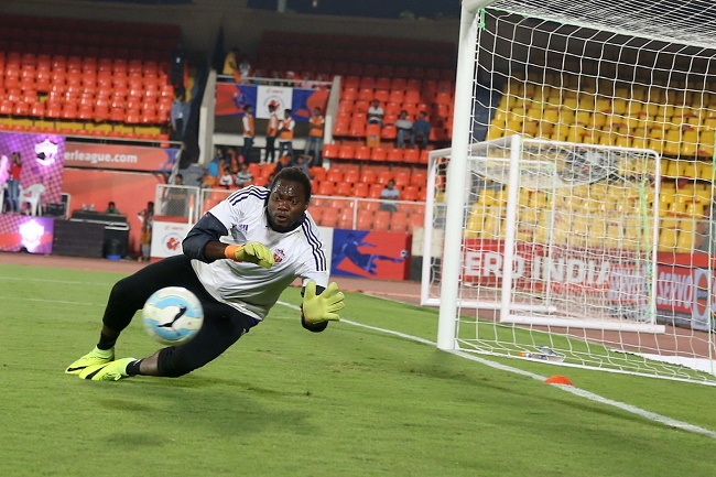FC Pune City goalkeeper Apoula Edima Edel Bete warm up before the match 21 of the Indian Super League (ISL) season 3 between FC Pune City and Chennaiyin FC held at the Balewadi Stadium in Pune, India on the 23rd October 2016.