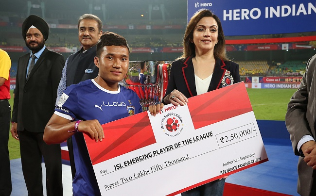 Jerry Lalrinzuala of Chennaiyin FC receives the ISL Emerging Player of the League Award from Nita Ambani Founder & Chairperson of Football Sports Development during the penalty shoot out of the Final of the Indian Super League (ISL) season 3 between Kerala Blasters FC and Atletico de Kolkata held at the Jawaharlal Nehru Stadium in Kochi, India on the 18th December 2016.