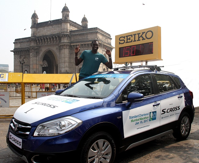 David Rudisha, Event Ambassador, Standard Chartered Mumbai Marathon 2017 with the official car, S-Cross of the SCMM 2017 at the Gateway of India