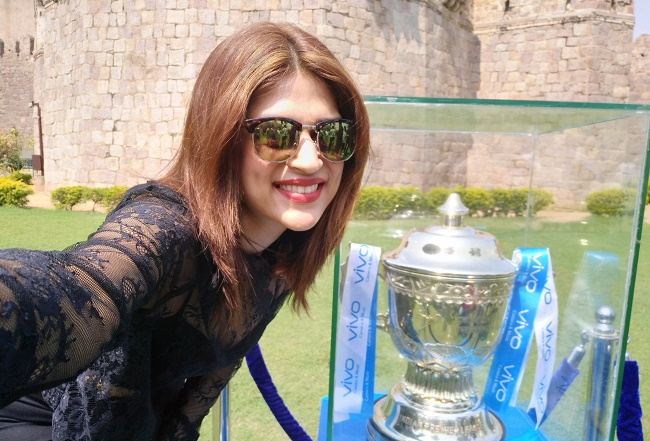 Actress Shradha Das poses with the VIVO IPL Trophy in Hyderabad