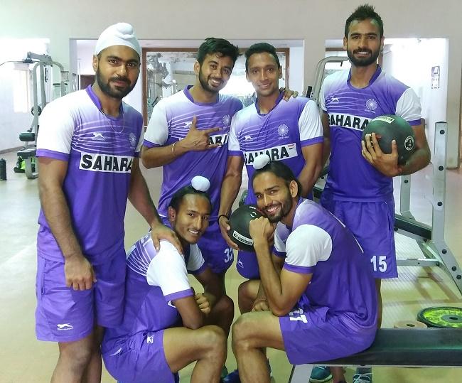 Manpreet Singh along with teammates