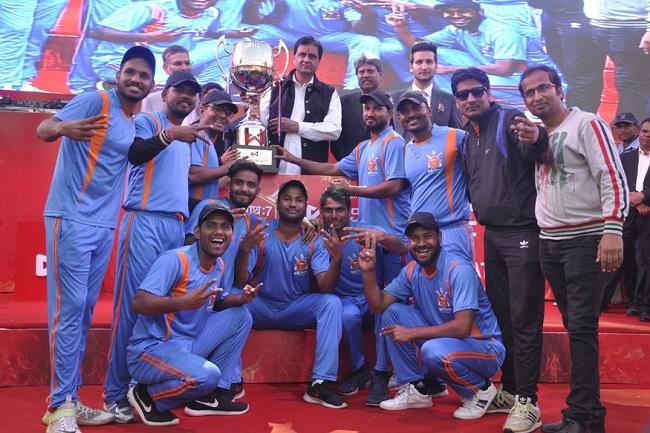 Shri Shyam Cricket Club from Jaipur poses with the winning Wonder Cement Saath7 Cricket Mahotsav trophy